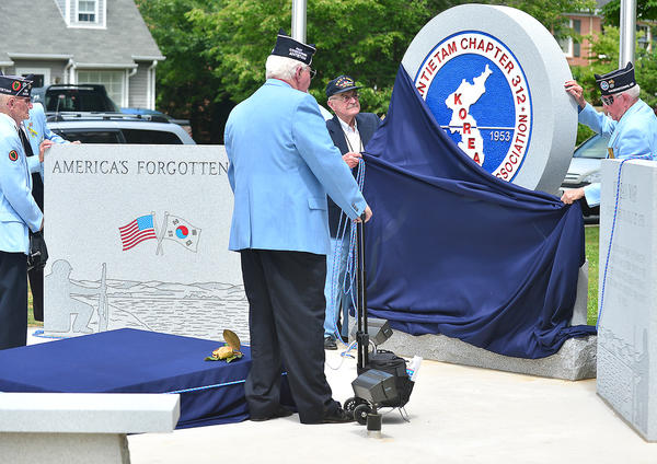 Monument committee members and members of Antietam Chapter 312 of the Korean War Veterans Association in Hagerstown unveil the new Korean War monument Sunday at Potomac Avenue and Mealey Parkway in Hagerstown.