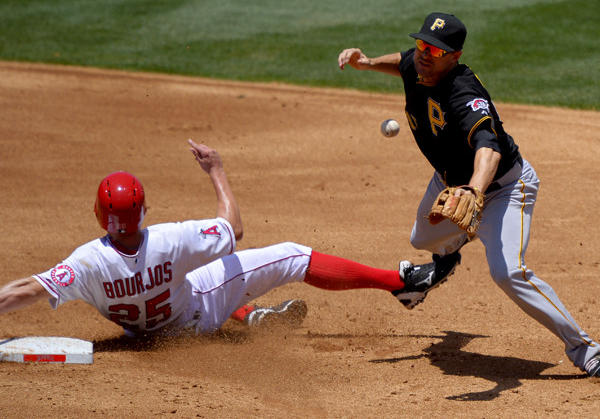 Angels' Peter Bourjos, left, is forced out at second, but breaks up Pittsburgh Pirates shortstop Jordy Mercer's double play attempt on a fielder's choice by Mike Trout and during the second inning.