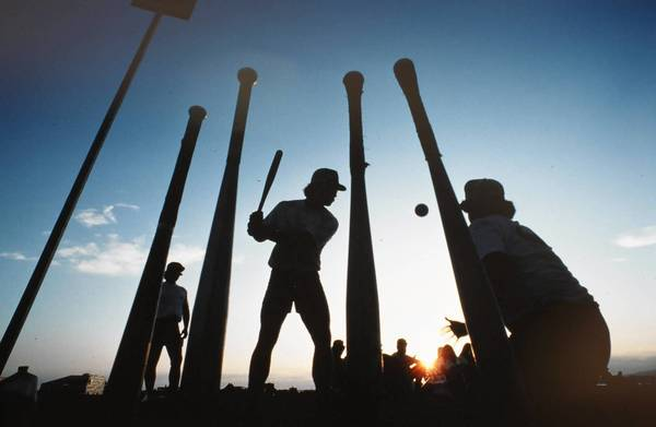 "Teams participate in San Diego's Over-the-Line tournament. The annual beach bacchanal has both its steadfast constituency and its vocal detractors, including a professor who says it's an example of the ""pornification of popular culture."" A lawsuit claims that city officials are playing favorites by denying a permit for a much smaller, more sedate party elsewhere."