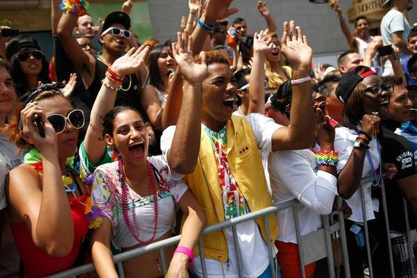 Spectators cheer for beads during the 43rd Annual Gay Pride Parade on Chicago's North Side on June 24, 2012.