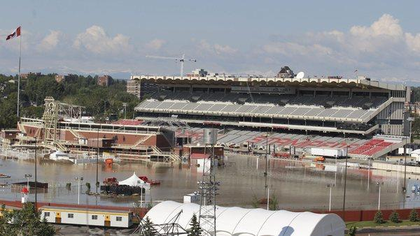 Floodwaters from the Elbow River cover the grandstand and track area at the Calgary Stampede grounds.