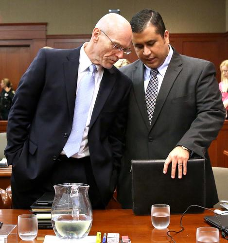 George Zimmerman talks with defense attorney Don West (left)  in Seminole circuit court on the 11th day of Zimmerman's trial, in Sanford, Fla., Monday, June 24, 2013. (Joe Burbank/Orlando Sentinel) newsgate CCI  B583011931Z.1