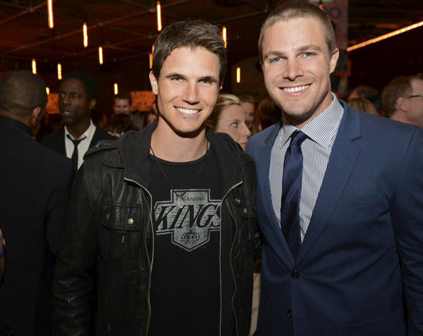 "Cousins Robbie Amell (""The Tomorrow People,"" left) and Stephen Amell (""Arrow"") can be seen on Wednesdays this fall on the CW."
