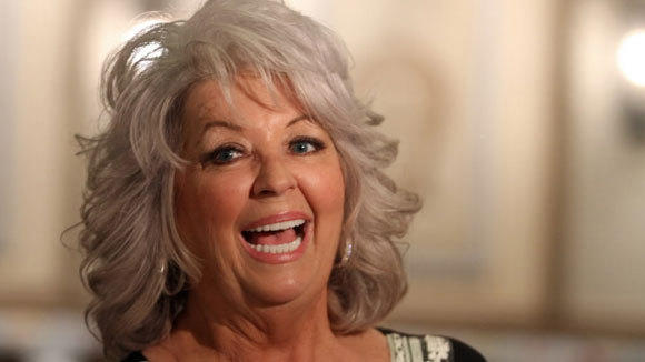 Chef Paula Deen surveys her first restaurant outside of the south, Paula Deen's Kitchen, at Harrah's Joliet Casino & Hotel, in April 2012.