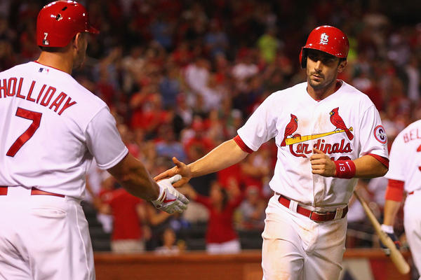 The Cardinals' Matt Carpenter is congratulated after hitting a solo home run.