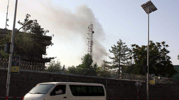 Smoke billows from the scene of a gunfight between Taliban militants and Afghan security officials near the presidential palace in Kabul, Afghanistan.