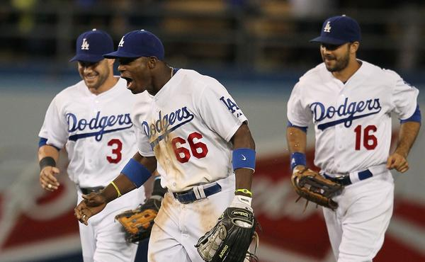 Dodgers right fielder Yasiel Puig, center, celebrates with left fielder Skip Schumaker, left, and center fielder Andre Ethier following their 3-1 victory over the San Francisco Giants.