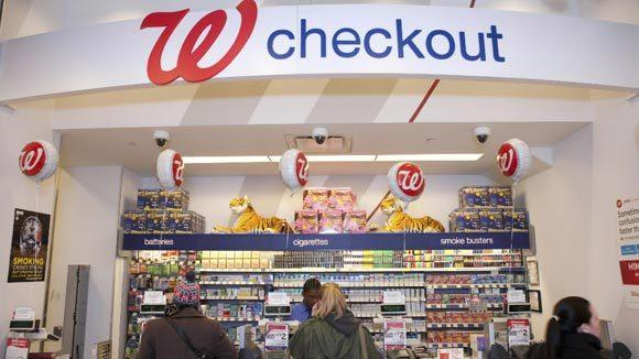 Shoppers check out at a Walgreen's store in New York.