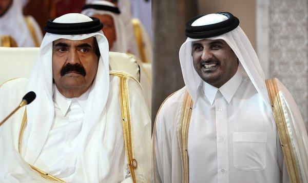 Qatar's emir, Sheik Hamad bin Khalifa al Thani, and his son, Sheik Tamim bin Hamad al Thani, attend the opening of the Arab League summit in the Qatari capital of Doha.