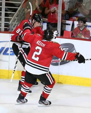 After Hawks' goalie Corey Crawford let the Wild's first shot of the postseason slip into the net, Marian Hossa answers with the first goal of the Hawks' playoff life in Game 1.