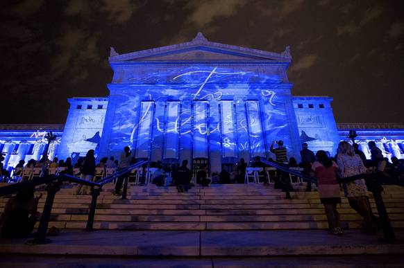 "Artwork is projected onto the exterior of the Field Museum in Chicago as part of Italian artist Marco Nereo Rotelli's ""Divina Natura."""