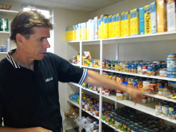Brian Leverenz, community services administrator for the New Trier Township, gives a tour of the food pantry. Donations are down this summer, he said, but the needs are not.