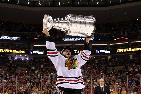 Blackhawks captain Jonathan Toews celebrates with the Stanley Cup following the Blackhawks' 3-2 victory in Game 6 on Monday.