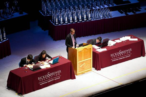 From left to right: Glenbrook High School District 225 representatves Nate Sawyer, Natalie Knez, Bobby Shaw and Ben Wolch compete in the final round of policy debate for a national title at the end National Forensic League's weeklong speech and debate tournament on June 21. It was the first time that two schools from the same district faced each other in the finals.