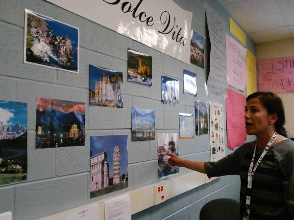 Lisa Sasso points to iconic images of Italy in her classroom at South Middle School.