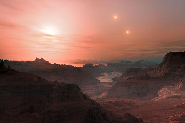 An artist's rendition of the view from one of three super-Earth planets orbiting Gliese 667C in its habitable zone. Two brighter but far-off stars in the trio, 667A and 667B, shine in the sky.