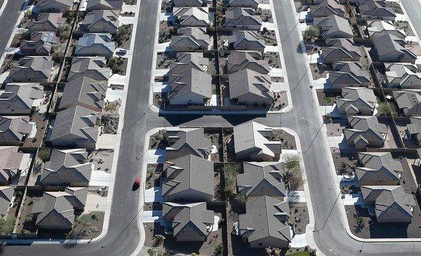 Higher mortgage interest rates could restrain the heavy demand for housing that has driven up home prices recently. Above, rows of homes in a housing development in Mesa, Ariz.