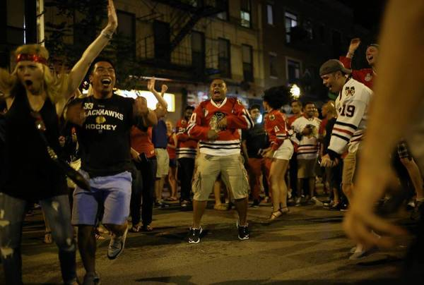 Fans celebrate the Blackhawks Stanley Cup victory on Madison Street, Monday June 24, 2013. B583017602Z.1 (E. Jason Wambsgans/Chicago Tribune) ....OUTSIDE TRIBUNE CO.- NO MAGS, NO SALES, NO INTERNET, NO TV, CHICAGO OUT, NO DIGITAL MANIPULATION...