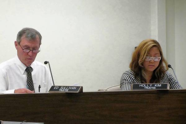 Trustees Ed Sullivan (left) and Holly Kim voted against a state mandate setting wages for village employees.