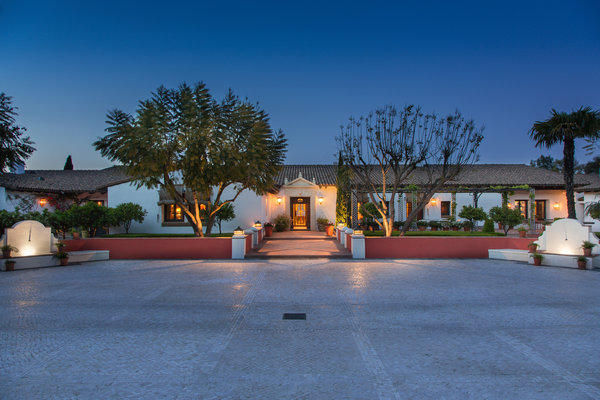 Hacienda de la Paz has come on the market in Rolling Hills for $53 million. A limestone motor court made by artisans from Portugal sits at the entrance to the house.