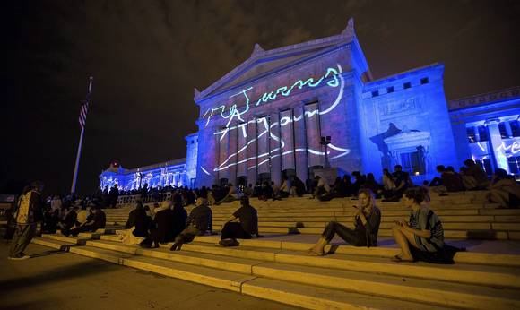 "Artwork is projected onto the exterior of the Field Museum in Chicago for ""Divina Natura."""