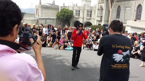 Michael Jackson impersonator Carlo Riley poses for fans at Forest Lawn Memorial Park on Tuesday.