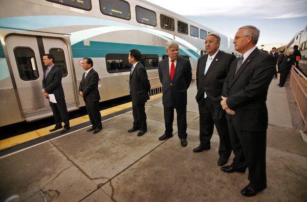 Metrolink officials unveil a new train car built by South Korean firm Hyundai in 2010.