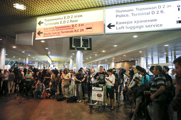 "Russian and foreign journalists have been staking out the arrival area of Moscow's Sheremetyevo airport since NSA leaker Edward Snowden flew there Sunday. Russian officials say he has not passed through passport control and remains in the ""transit zone,"" not technically on Russian soil."