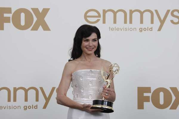 "Julianna Margulies, here clutching an Emmy for her role on ""The Good Wife,"" is battling her former manager in court."