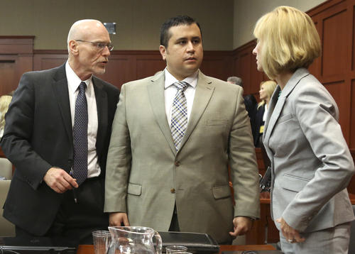 Don West, left, and Lorna Truett, talk with their client George Zimmerman during his trial in Seminole circuit court in Sanford, Fla. Tuesday, June 25, 2013. Zimmerman has been charged with second-degree murder for the 2012 shooting death of Trayvon Martin. (Gary W. Green/Orlando Sentinel)