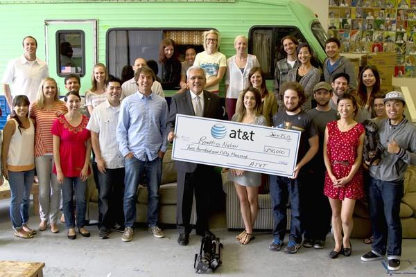 "AT&T presents a check for $250,000 to Roadtrip Nation founders, staff and student ""Roadtrippers."""