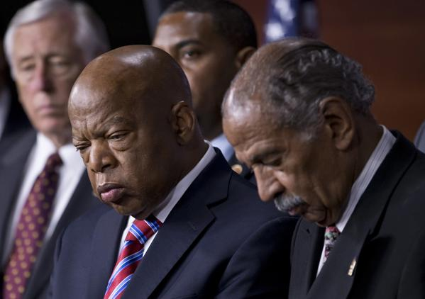 In ruling unconstitutional a key part of the 1965 Voting Rights Act, the U.S. Supreme Court has opened the door for state and local governments with a history of discriminating against minorities to engage in subtle forms of disenfranchisement. Above: Rep. John Lewis (D-Ga.), center, and Rep. John Conyers (D-Mich.), right, co-chairs of the Civil Rights Taskforce of the Congressional Black Caucus, join other members of the House to express disappointment in the Supreme Court's decision.