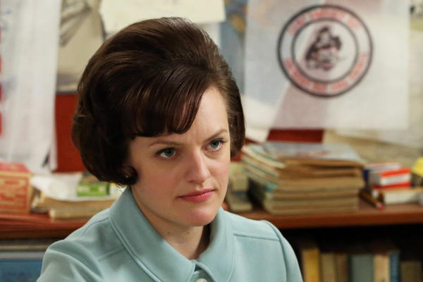 "Elisabeth Moss, left, plays Peggy Olson on ""Mad Men."" She is seen in a scene with Kevin Rahm."
