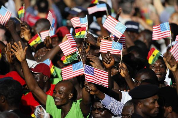 People in Accra, Ghana, cheer during a departure ceremony for President Obama after his visit in July 2009.