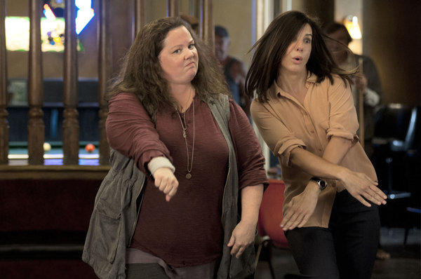 "Detective Shannon Mullins (Melissa McCarthy, left) and FBI special agent Sarah Ashburn (Sandra Bullock) bust some moves during a night out on the town in the movie ""The Heat."""