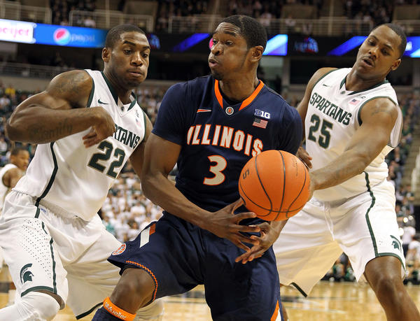 Illinois guard Brandon Paul loses the ball against Michigan State guard Branden Dawson, left, and Spartans center Derrick Nix during first half of an 80-75 loss on Jan. 31. (USA Today Sports Photo)
