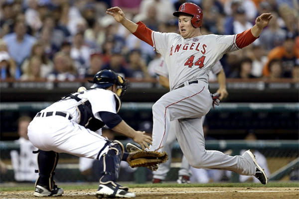 Mark Trumbo scores on a Josh Hamilton single as Detroit's Bryan Holaday is unable to wrangle the throw to the plate during the Angels' victory over Detroit, 14-8.