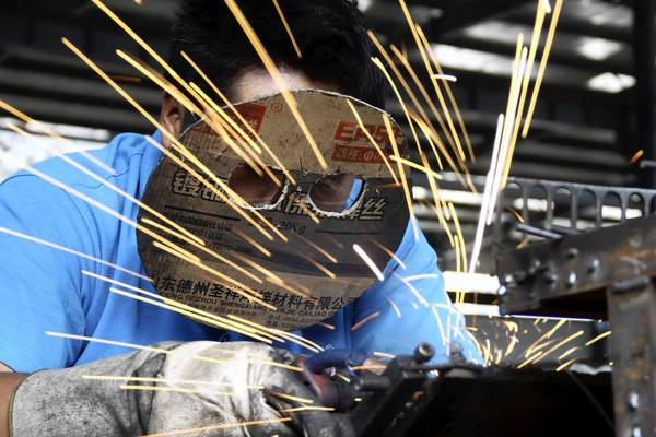 An employee works at a bicycle factory in China, where economic growth has slowed considerably.