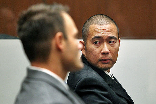 Former officers Evan Samuel, left, and Richard Amio in court last November.