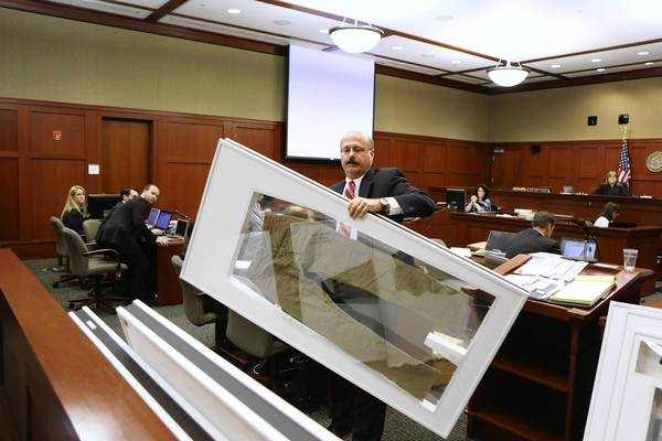 Assistant State Atty. Bernie de la Rionda shows Trayvon Martin's pants as evidence during George Zimmerman's murder trial in Sanford, Fla.