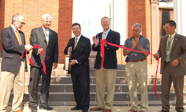 The Franklin County Commissioners cut a ribbon Tuesday to celebrate the expansion and renovation of the county courthouse complex. From left are Michael Allen-Hall from the Noelker & Hull architectural firm; County Administrator John Hart; Commissioner David Keller; Commissioner Bob Ziobrowski; Chambersburg Mayor Pete Lagiovane; and Court Administrator Mark Singer.