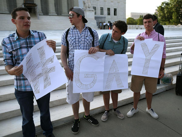 Gay rights activists gather in front of the U.S. Supreme Court building, June 26, 2013 in Washington, D.C.