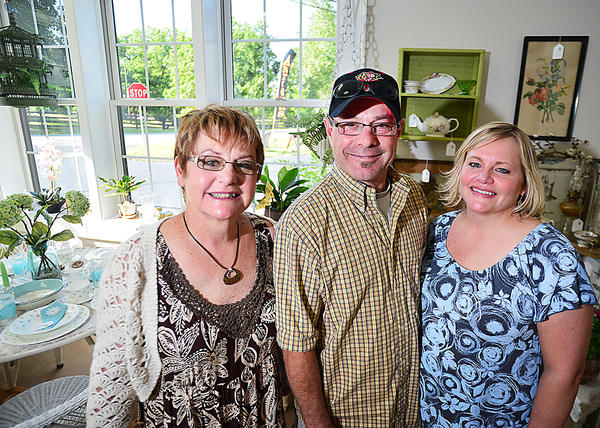 From left, Patty Barnes, Wayne Seilhamer and Denise Seilhamer own Meadowcreek Antiques & Uniques LLC at 21257 Leitersburg Pike in Hagerstown. The business, which opened April 6, offers antiques and unique gift items.