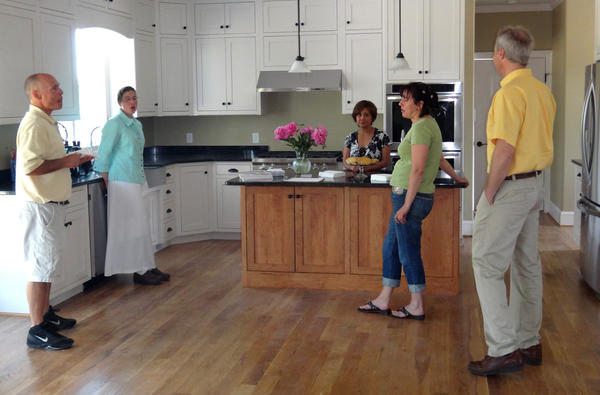 Homeowners John and Irene Everline, far left and third from left, talk with guests at their Keedysville home.