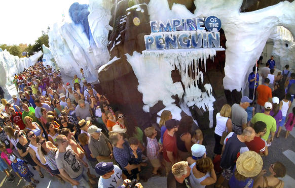 Guests jam the entrance of the 'Antarctica: Empire of the Penguins' attraction, after the grand opening ceremony at SeaWorld Orlando, Friday, May 24, 2013.   (Joe Burbank/Orlando Sentinel)