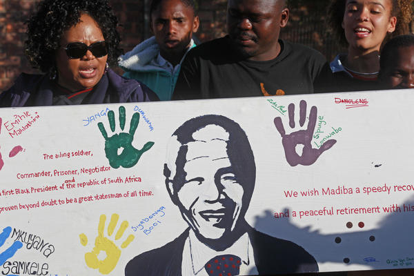 Visitors from the Nelson Mandela museum bring messages of support to the home of the former South African president in the village of Qunu.