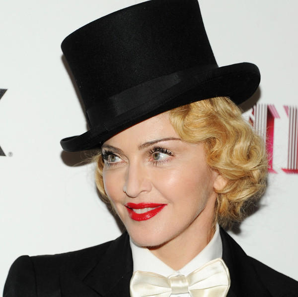 After a two-year absence from the music scene, Madonna is back in business as 2013's biggest earner with $125 million banked.