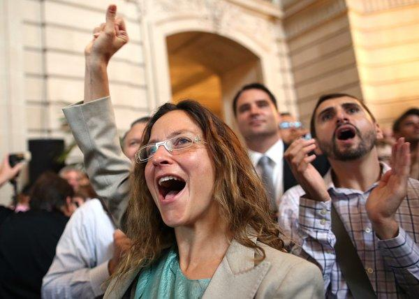 Supporters of same-sex marriage cheer at San Francisco City Hall on Wednesday as they learn results of the U.S. Supreme Court's rulings on gay marriage.