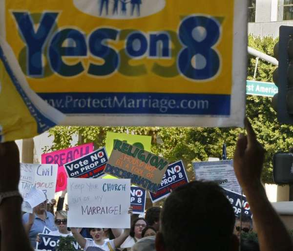 Supporters and opponents of Proposition 8 confront each other at a rally about five years ago.