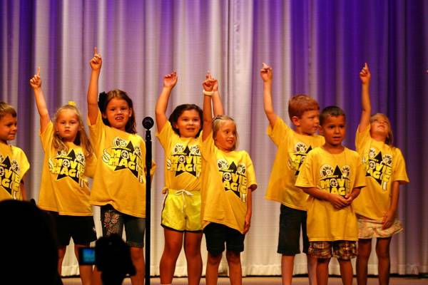 Children praised God after a performance during last year's Spotlight Youth Theater Summer Camp at Calvary Church in Orland Park.